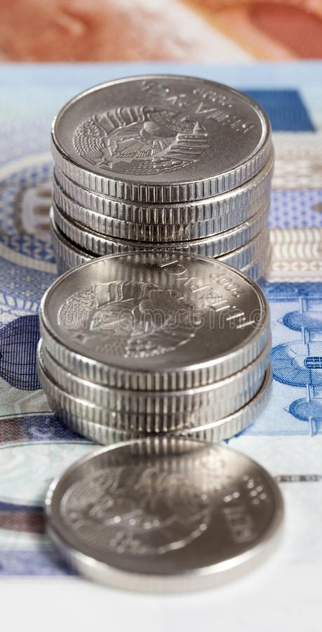 Metal coins. From which the ladder is folded up, close-up on cash banknotes, coins and banknotes Belarus stock photography