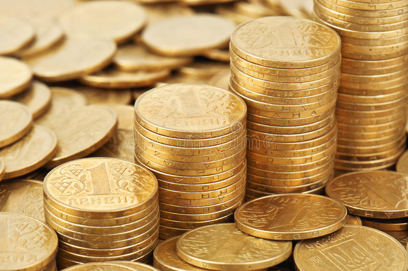 Metal coins. Metal yellow coins in the photo stock image