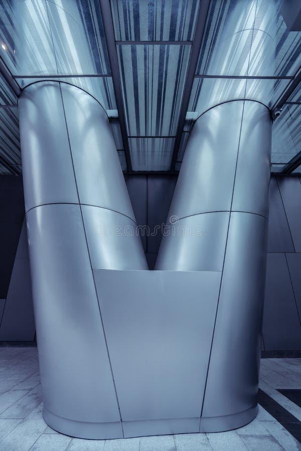 Metal column in modern futuristic architecture stock images