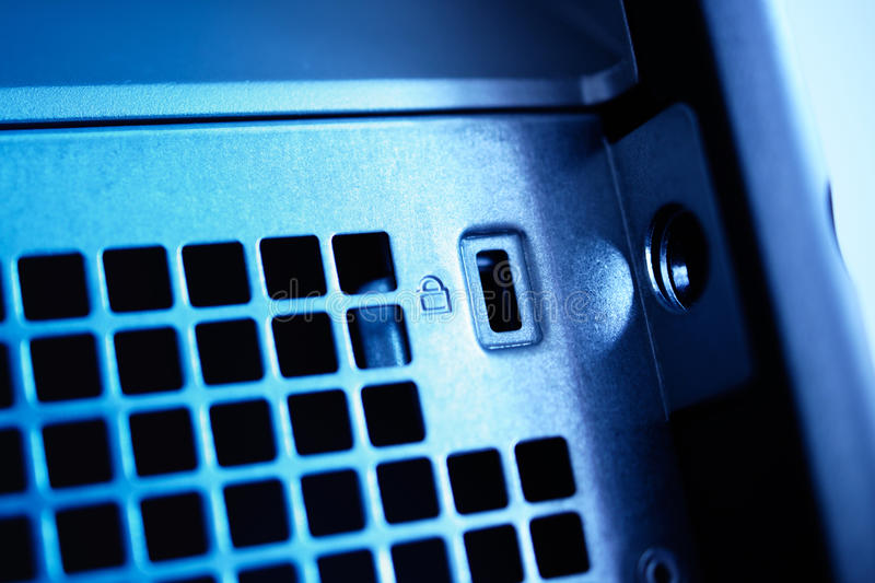 Metal computer lock on a blue server workstation. In data center royalty free stock photography