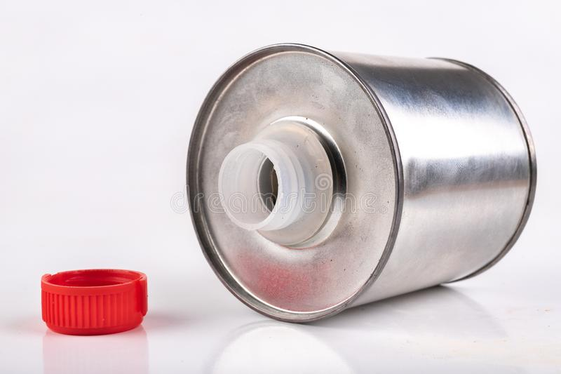 Metal container for chemicals on a white table. A tin plate with a plastic stopper royalty free stock photo