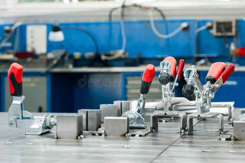 Metal corners clamped with clamps. Workplace welder stock photography
