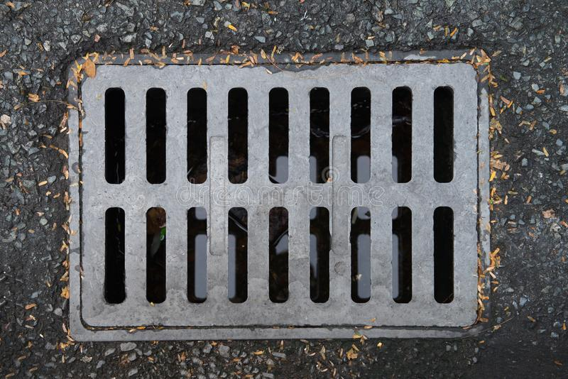 The metal cover for the drainage on the street stock images