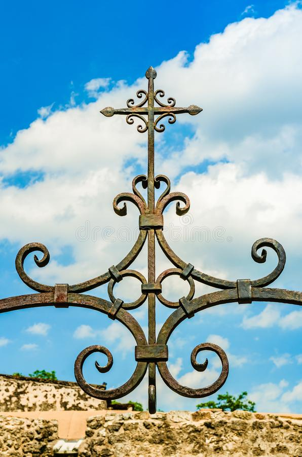 The metal cross on top of the Mission Concepcion church in San Antonio, Texas. San Antonio, Texas: The metal cross on top of the fountain in front of the Mission royalty free stock photography