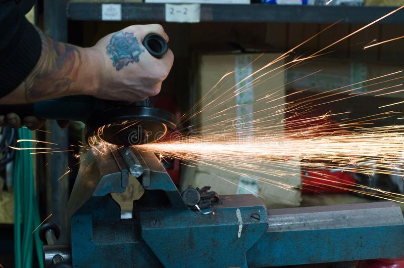 Metal cutting by grinder stock image