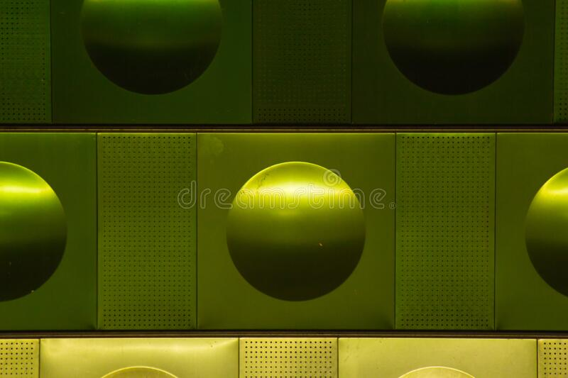 Metal decorations on the wall of Prague metro station. Background for advertising, announcements and congratulations.  royalty free stock image