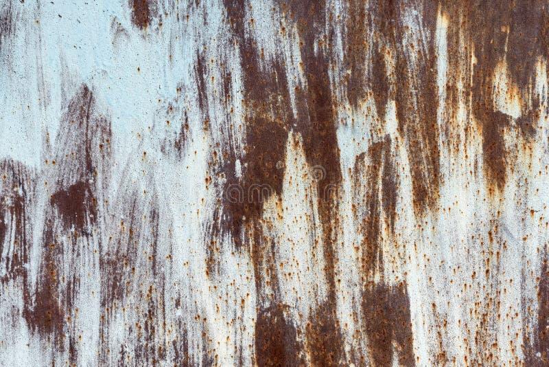 Metal desigualmente pintado oxidado velho da textura foto de stock royalty free