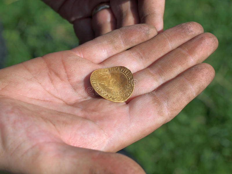 Jew Detector: Gold Coin Found With Metal Detector Stock Photo
