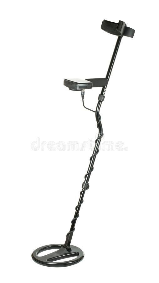metal detector and sand scoop on a sunny beach stock photo