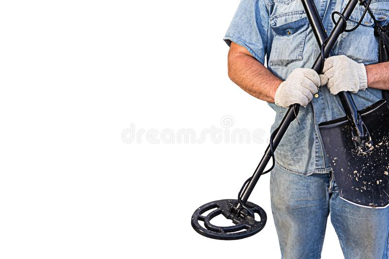 Metal detector shovel scan surface searching for treasure coins in the hands of a man on a white isolated background royalty free stock photo