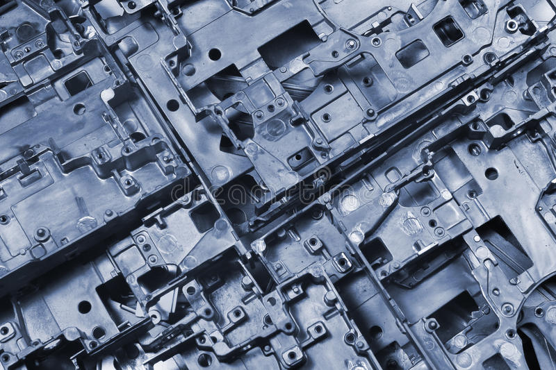 Metal die cast pieces - abstract industrial background.  stock photos