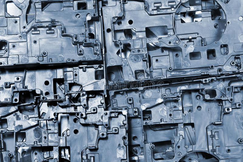 Metal die cast pieces - abstract industrial background.  royalty free stock image