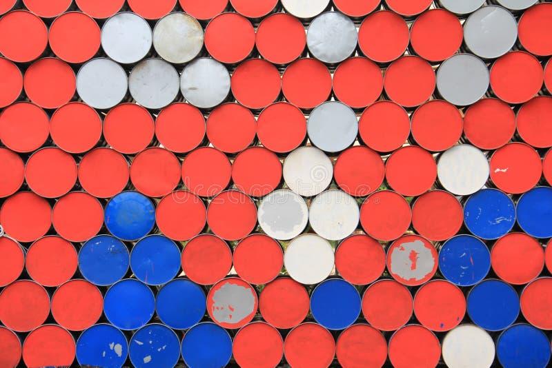 Metal dirty barrels wall stock photo