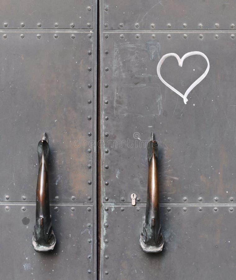 Door handles and a heart stock photos