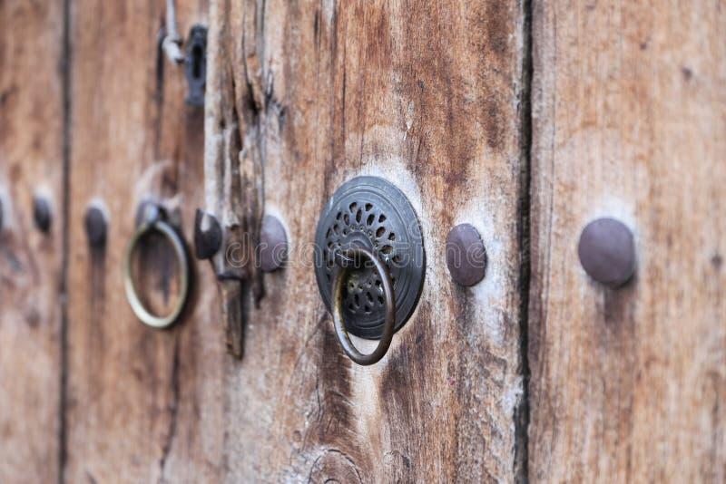 Metal Doorknob on Wooden Door stock photography