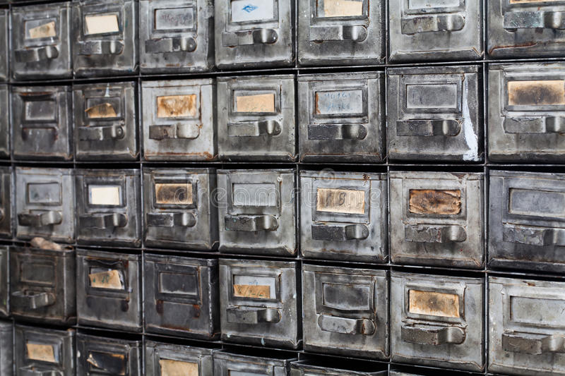 Metal drawers. Closed archive storage, filing cabinet interior. aged silver metallic boxes with index cards. library royalty free stock photo