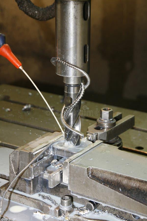 Metal drill press. A metal drill press at work stock photos
