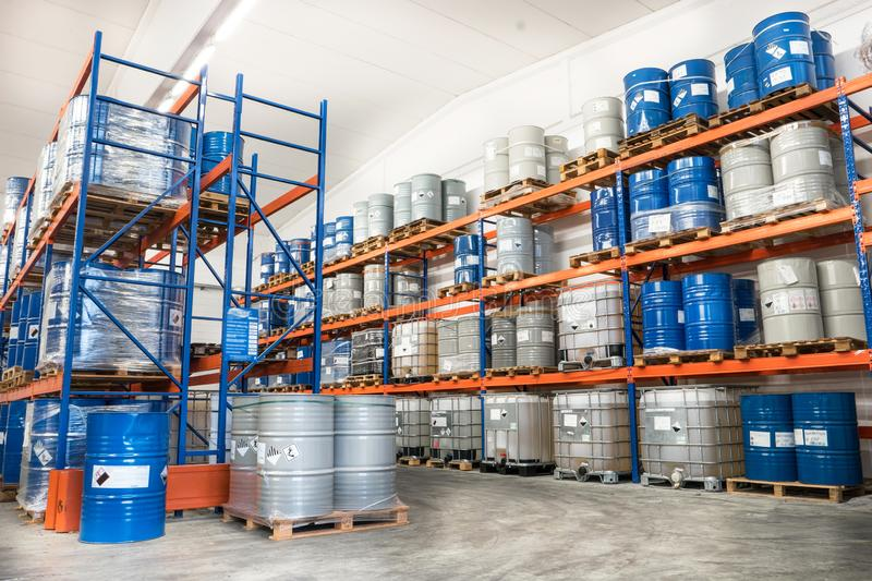 Metal drums stored in warehouse stock photo
