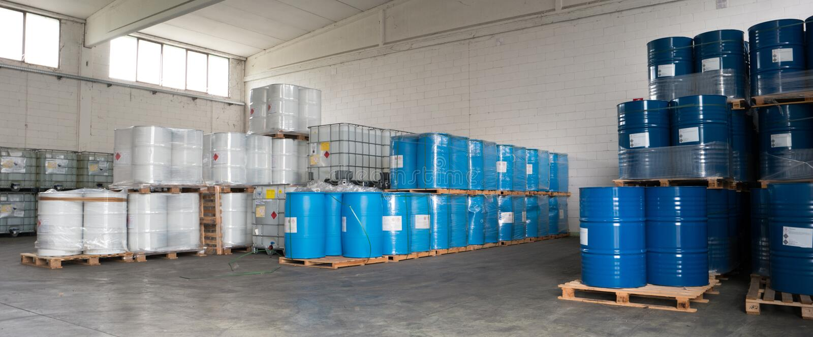Metal drums stored in warehouse royalty free stock photos