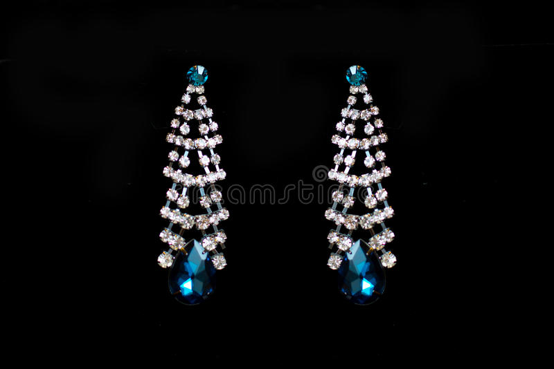 Metal earrings with blue stones stock photography