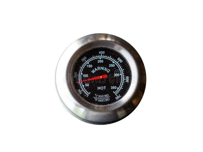 Metal el sensor de temperatura con el indicador rojo y las letras blancas los grados Celsius y Fahrenheit con la trayectoria de r fotografía de archivo