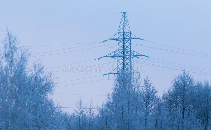 Metal electric pole in the winter in nature royalty free stock photo