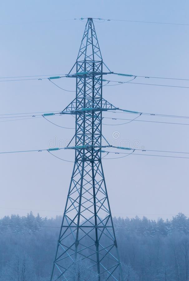Metal electric pole in the winter in nature stock image