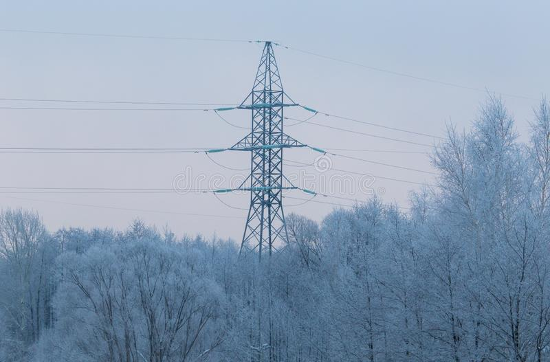 Metal electric pole in the winter in nature royalty free stock photography
