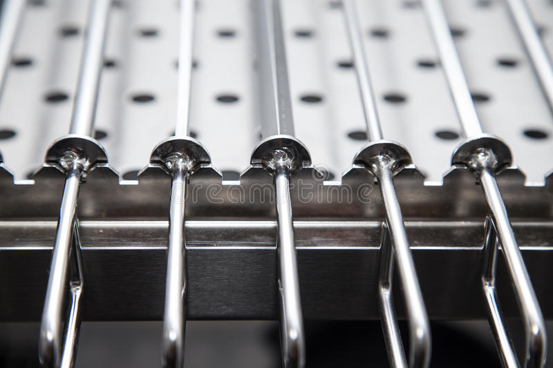 Metal equipment for drying dishes on professional kitchen. Selective focus. Shallow depth of field royalty free stock photo