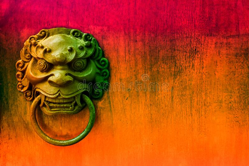 metal evil face pull gate and hard wood surface background royalty free stock photography