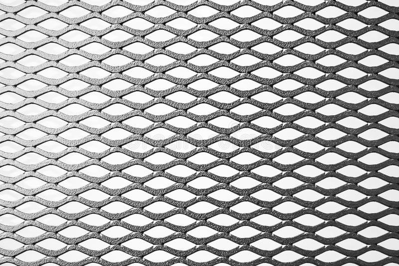 Metal expanded lath on white background. Black metal expanded lath on white background royalty free stock photo