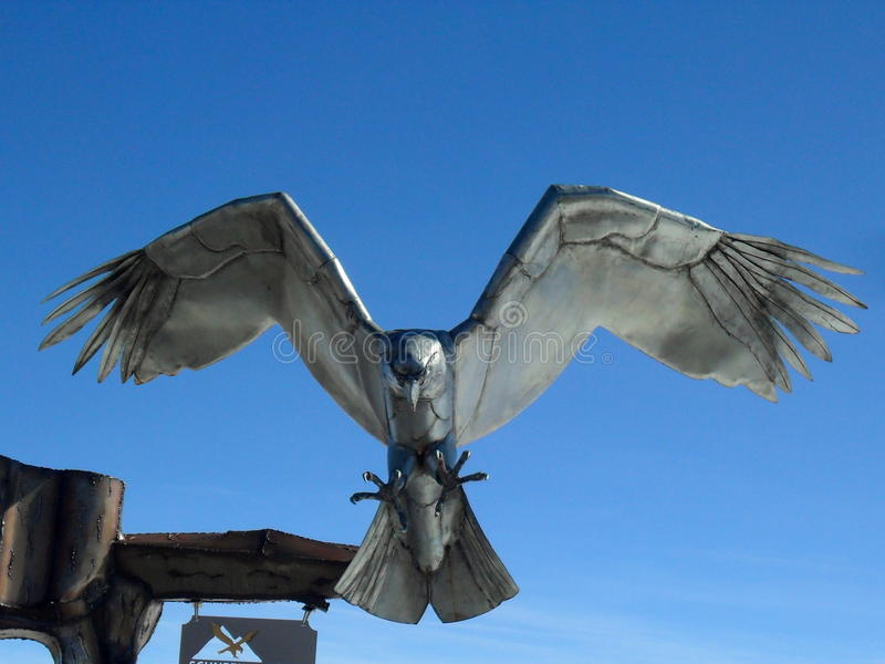 Metal falcon. Metal sculpture of a falcon diving royalty free stock photography