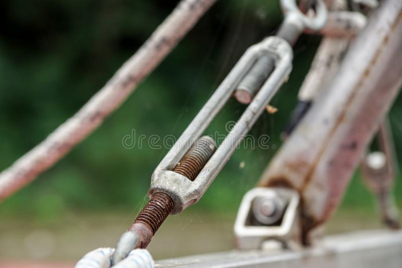 Metal fastening of two steel cables . stock photo