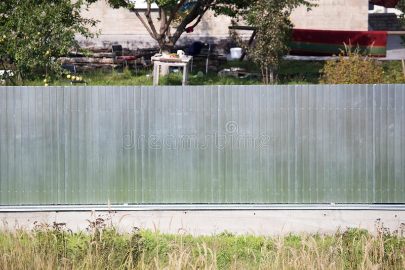 Metal fence on the cottage site. As a background royalty free stock image