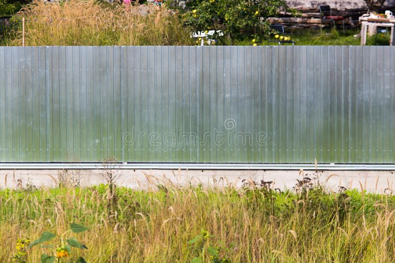 Metal fence on the cottage site. As a background stock image