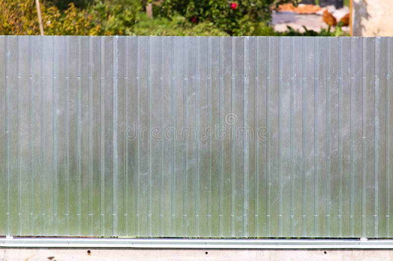 Metal fence on the cottage site. As a background stock photography