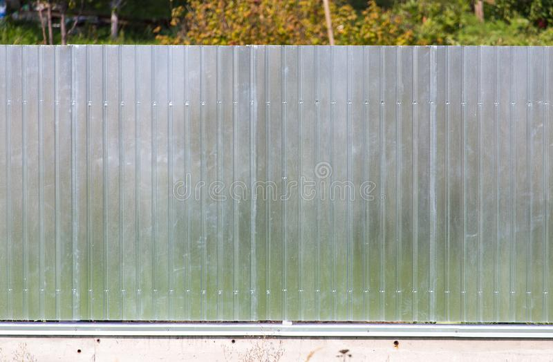 Metal fence on the cottage site. As a background stock photos