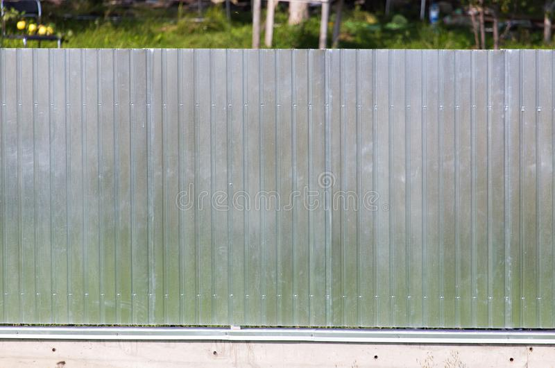 Metal fence on the cottage site. As a background royalty free stock photos