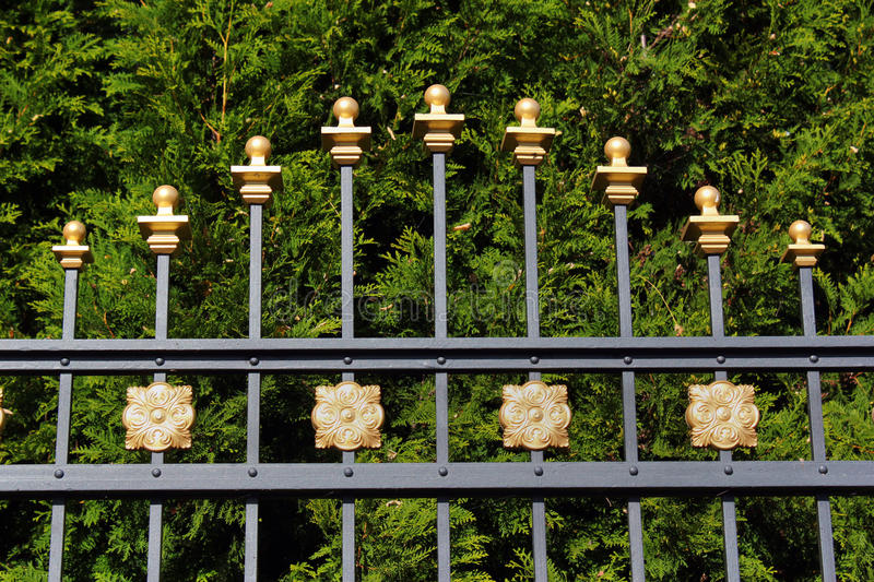 Metal fence of a formal park closeup stock images