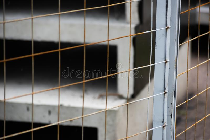 Metal fence mesh with precast concrete. Soft focus, construction, building, industry, cement, engineering, industrial, stack, site, house, technology, block stock images