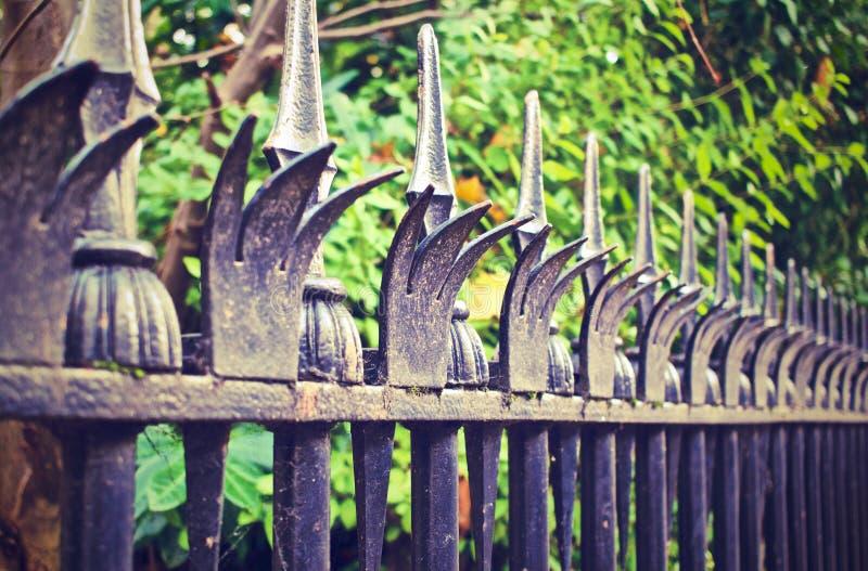 Metal fence spikes stock photos