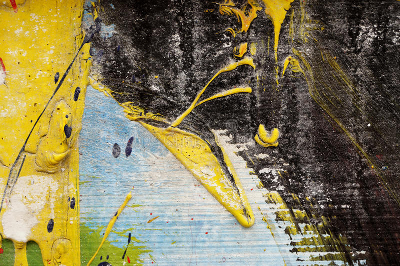 Metal fence with yellow, black,blue,white and green paint stock photo