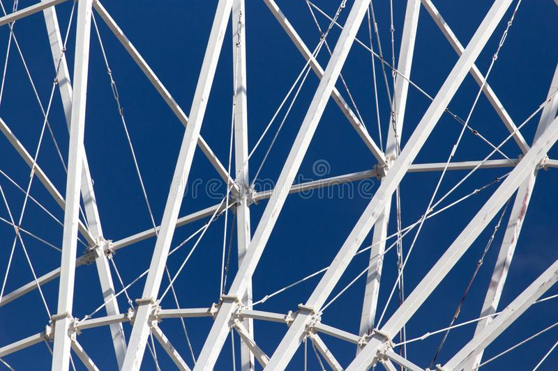 Metal Ferris wheel against the blue sky stock photography