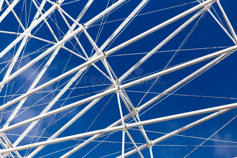 Metal Ferris wheel against the blue sky stock photos