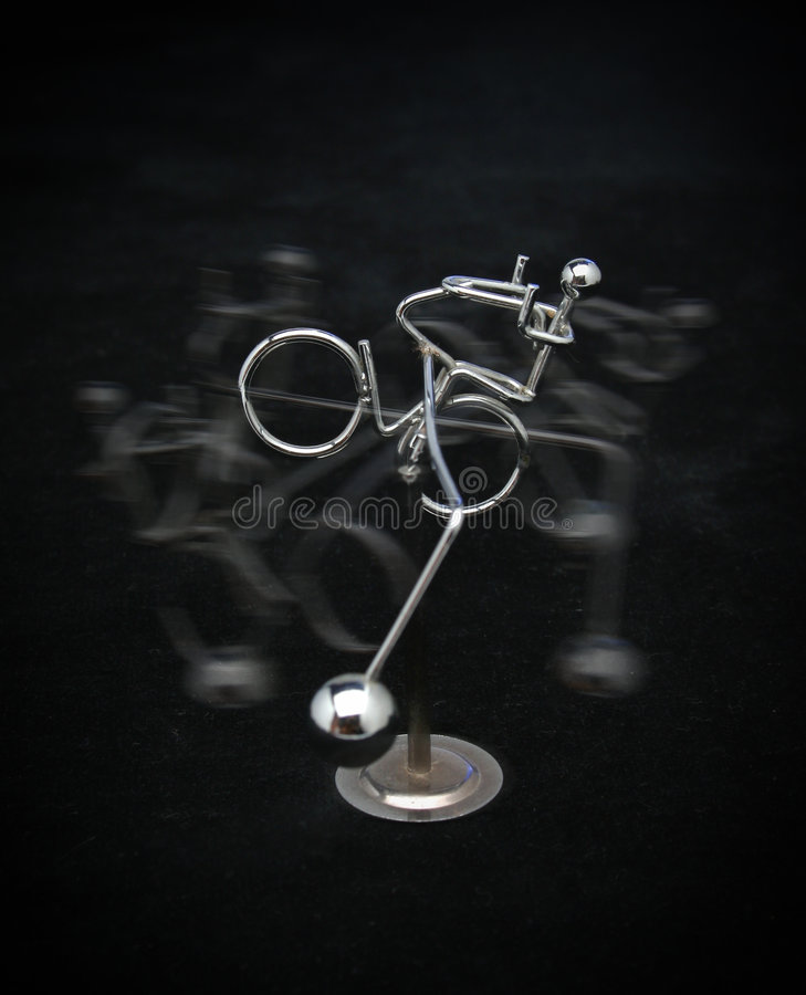Download Metal Figure Riding A Bicycle Stock Photo - Image: 596670