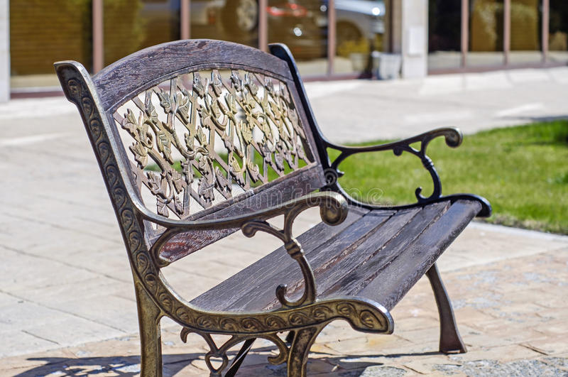 Metal filigree bench. Near hotel royalty free stock photography