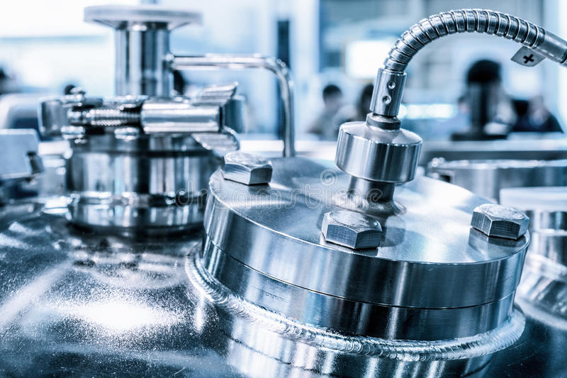 Metal flanges with flexible nipples, chemical reactor body, selective focus. Abstract industrial background stock photos