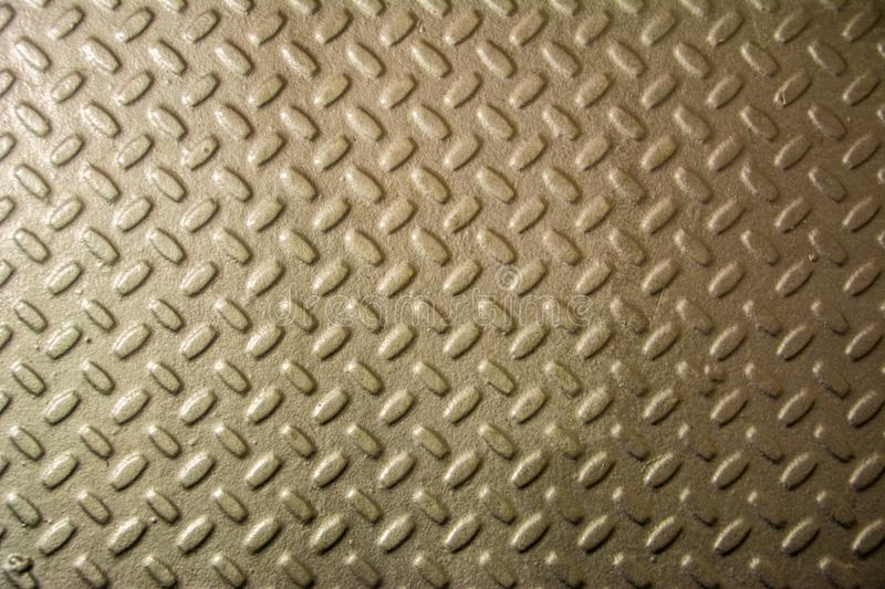 Metal floor plate with diamond pattern. Steel plate metal texture royalty free stock photo
