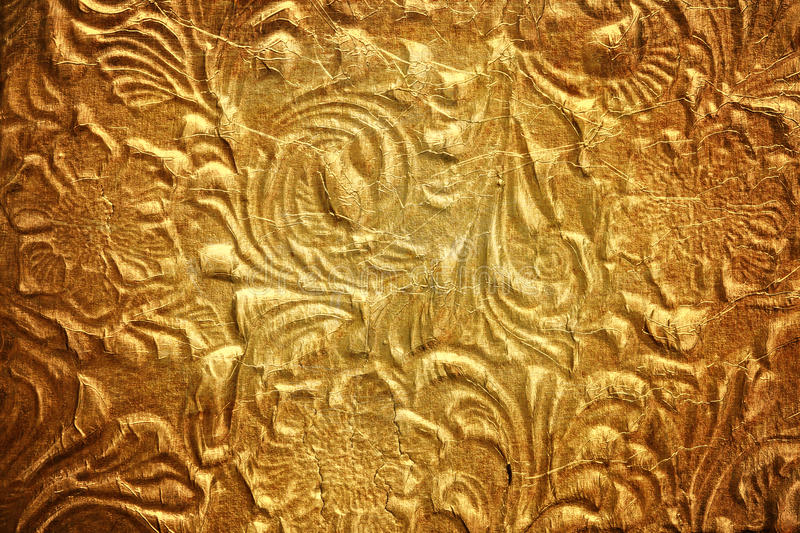 Metal with floral pattern. Golden metal with floral pattern royalty free stock photography