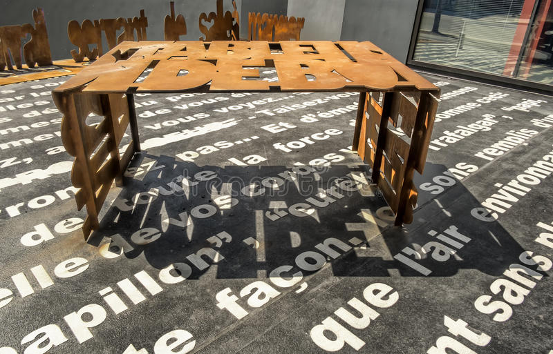 Metal Font Rusted Table. 1977 NCT becomes owner of Granada renovating it to accommodate 850 theater goers. The Granada was renamed Théâtre Denise-Pelletier royalty free stock photography